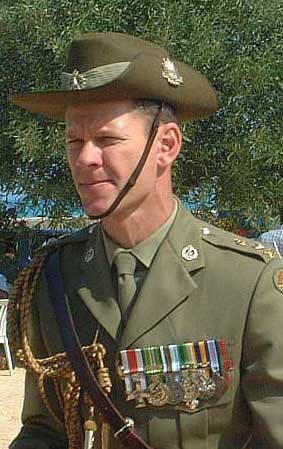 Australian aide de camp laying wreath